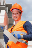 Builder with brick and spatula Royalty Free Stock Photo