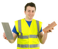 A builder with a brick and a trowel Stock Photos