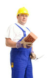 Builder with brick and trowel Royalty Free Stock Image