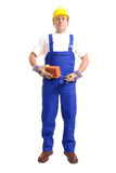 Builder with brick and trowel Stock Image