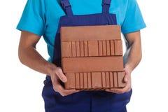 Builder with bricks Royalty Free Stock Photos