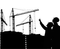 Builder and building silhouettes Royalty Free Stock Image