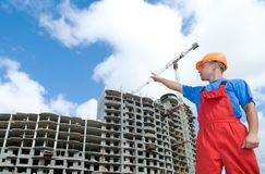 Builder and building under Stock Images