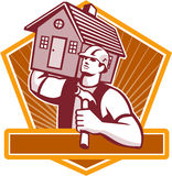 Builder Carpenter Carry House Retro. Illustration of a builder construction worker with hammer carrying house on shoulder set inside shield done in retro style Royalty Free Stock Photos