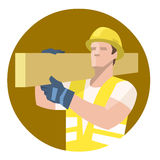 Builder carpenter carrying heavy wooden plank on shoulder Stock Images