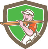 Builder Carpenter Carrying Timber Shield Cartoon. Illustration of a carpenter builder with hammer carrying timber wood on shoulder set inside shield crest on Stock Photos