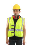 Builder, carpenter, construction worker. A builder, construction, worker, carpenter or other labourer wearing protective clothing.  He is looking down and Stock Photo