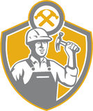 Builder Carpenter Hammer Shield Retro. Illustration of a carpenter builder holding hammer set inside shield crest shape on isolated background Royalty Free Stock Images
