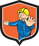 Builder Carpenter Hands Out Cartoon. Illustration of a builder construction worker carpenter hands out traffic hand signal set inside shield crest done in Royalty Free Stock Image