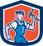 Builder Carpenter Holding Hammer Cartoon. Illustration of a builder construction worker carpenter holding hammer set inside shield crest done in cartoon style Stock Photo
