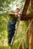 Builder or carpenter working and builds a roof Royalty Free Stock Image