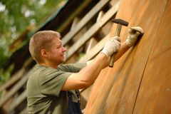 Builder or carpenter working and builds a roof Stock Photo