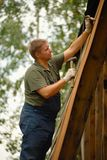 Builder or carpenter working and builds a roof Royalty Free Stock Photos