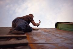 Builder or carpenter working on the roof Royalty Free Stock Photography