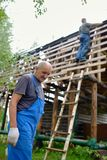 Builder or carpenter working on the roof Royalty Free Stock Photo