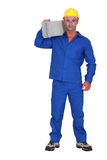 Builder carrying a block Stock Photography