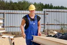 Builder carrying an insulated wooden wall panel Stock Photography