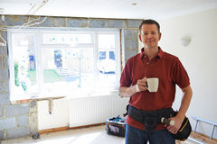 Builder Carrying Out Home Improvements Taking A Break. Portrait Of Builder Carrying Out Home Improvements Taking A Break Royalty Free Stock Photos