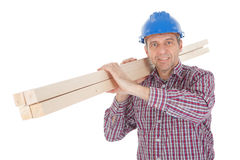 Builder carrying timber Royalty Free Stock Photography