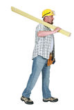 Builder carrying timber Stock Photo