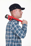 Builder carrying wrench Royalty Free Stock Images