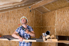 Builder with Caulking Gun Inside Unfinished Home Royalty Free Stock Photography