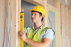 Builder Checking Work With Spirit Level Royalty Free Stock Photography