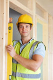 Builder Checking Work With Spirit Level Royalty Free Stock Images