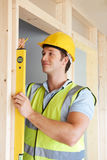 Builder Checking Work With Spirit Level Stock Image
