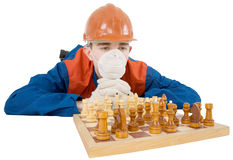 Builder and chess Royalty Free Stock Photo