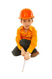 Builder child boy measure floor Royalty Free Stock Images