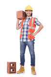 Builder with clay bricks Stock Image