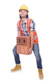 Builder with clay bricks Royalty Free Stock Photos
