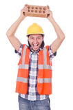 Builder with clay bricks Stock Photos