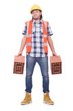 Builder with clay bricks Royalty Free Stock Image