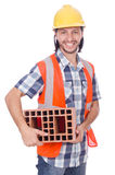 Builder with clay bricks Stock Photo