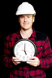 Builder with clock showing home time Royalty Free Stock Photography
