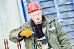 Builder concreter  worker at construction site Royalty Free Stock Photo