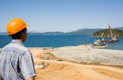 Builder.Construction of new seaport. stock images
