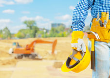 The builder on the construction place Stock Photos