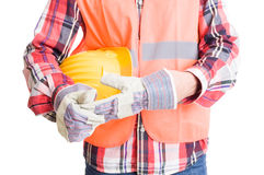 Builder or construction worker pulling out glove Royalty Free Stock Image