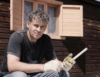 Builder of a country house. The Builder of a country house with a tape measure in his hands Stock Image
