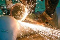 Builder cuts metal cutting machine stock image