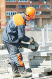Builder at cutting curb work Royalty Free Stock Images