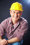 Builder on a dark background Royalty Free Stock Photos