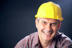 Builder on a dark background Stock Photo