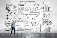 Builder demonstarting his success strategy Stock Photo