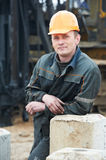 Builder in dirty workwear at construction site Stock Images