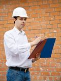 Builder with documents Stock Photo