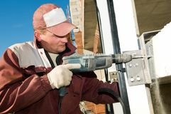 Builder with drill Stock Photo